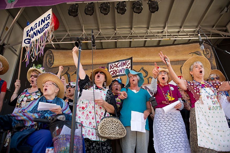 A protest group calling themselves the Raging Grannies sing on stage  as hundreds of protesters, upset about a variety of issues from the ongoing wars in Afghanistan and Iraq to corporate greed and jobs, gather at Freedom Plaza before marching to the White House, Chamber of Commerce and along K Street in NW Washington, DC, October 6,  2011. (Andrew Harnik / The Washington Times)