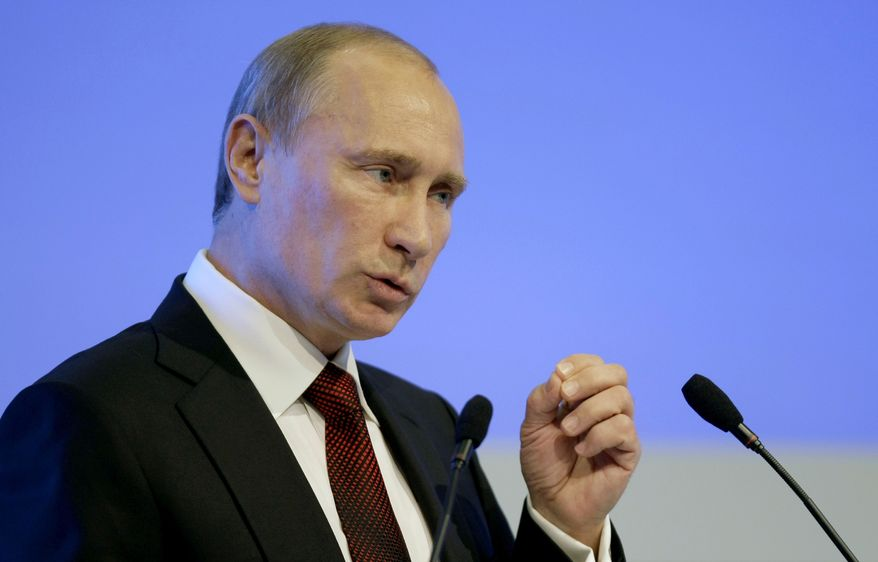 Russian Prime Minister Vladimir Putin tells an investment forum in Moscow on Thursday, Oct. 6, 2011, that Russia is strong enough to withstand economic shocks. (AP Photo/Misha Japaridze)