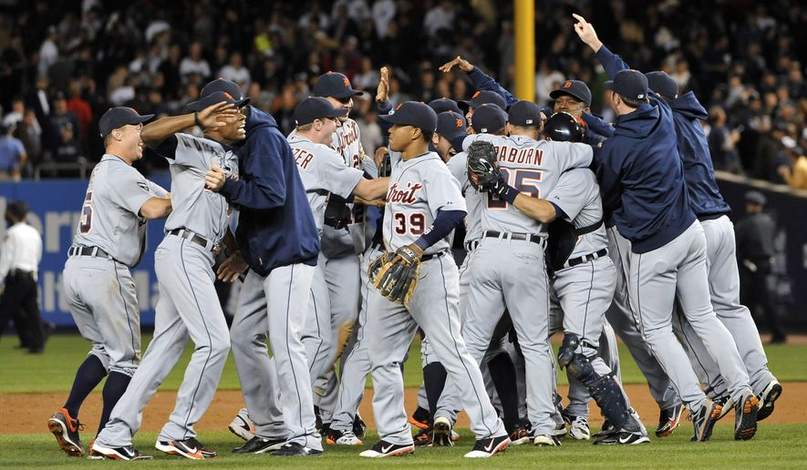 Detroit Tigers celebrate after winning Game 5 of baseball's American League division series 3-2 over the New York Yankees on Thursday, Oct. 6, 2011, in New York. (AP Photo/Kathy Kmonicek)