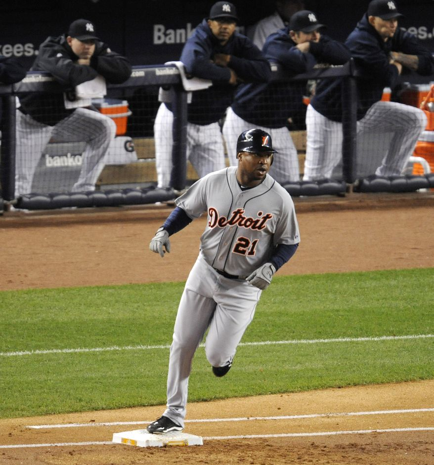 Detroit Tigers' Delmon Young rounds first base after hitting a home run off New York Yankees pitcher Ivan Nova in the first inning during Game 5 of baseball's American League division series Thursday, Oct. 6, 2011, at Yankee Stadium in New York. (AP Photo/Bill Kostroun)