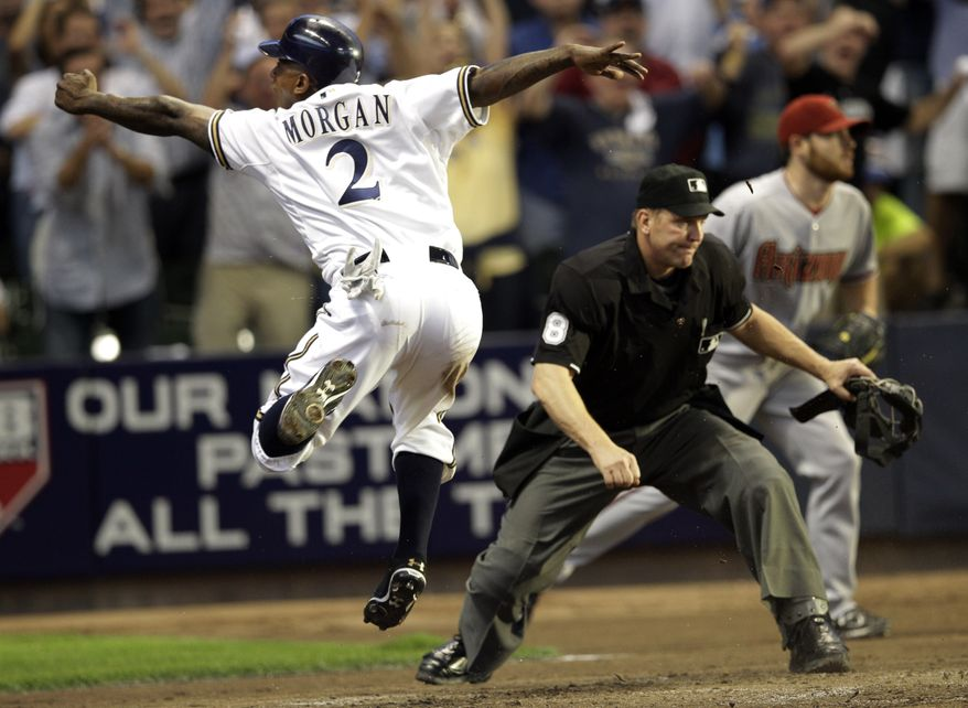 Milwaukee Brewers' Nyjer Morgan (2) reacts after scoring during the fourth inning of Game 5 of baseball's National League division series against the Arizona Diamondbacks Friday, Oct. 7, 2011, in Milwaukee. (AP Photo/David J. Phillip)