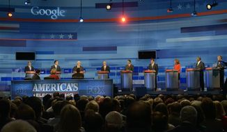 Republican presidential candidates from left, former New Mexico Gov. Gary Johnson, former Pennsylvania Sen. Rick Santorum, former House Speaker Newt Gingrich, Rep. Ron Paul, R-Texas, Texas Gov. Rick Perry, former Massachusetts Gov. Mitt Romney, Rep. Michele Bachmann, R-Minn, businessman Herman Cain and former Utah Gov. Jon Huntsman gather prior to a debate, Thursday, Sept. 22, 2011, in Orlando, Fla. (AP Photo/Phelan M. Ebenhack, Pool)