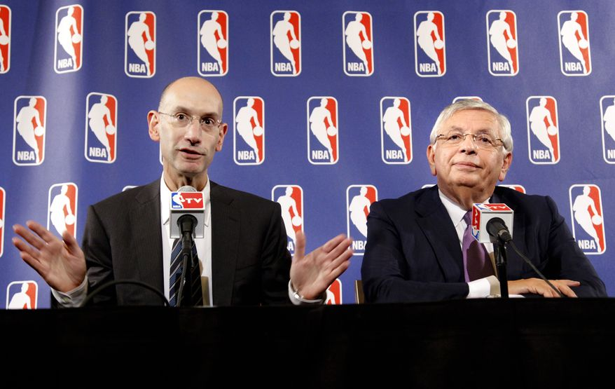 NBA Commissioner David Stern, right, listens as deputy commissioner Adam Silver speaks during a news conference following NBA labor talks meeting between basketball players and owners on Tuesday, Oct. 4, 2011, in New York. (AP Photo/Bebeto Matthews)