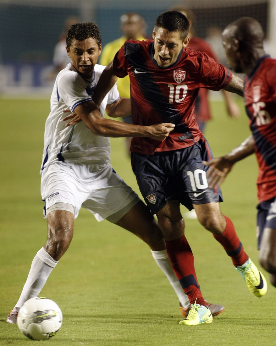 United States' Clint Dempsey, right, fights for the ball with Honduras' Mauricio Sabillon left, during the second half of an international friendly soccer game in Miami, Fla. Saturday Oct. 8, 2011. Dempsey scored the only goal of the game in the USA's 1-0 win. (AP Photo/Jeffrey M. Boan)