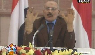 """In this image made from video, Yemen's President Ali Abdullah Saleh speaks on Yemen State Television broadcast Saturday, Oct. 8, 2011. The TV broadcast showed Saleh talking to unidentified members of the Yemen parliament, railing against the opposition and calling the crisis a """"conspiracy"""" against him. (AP Photo/Yemen State TV)"""