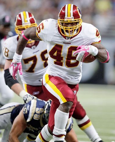 Washington Redskins running back Ryan Torain runs for a 20-yard touchdown during the second quarter of the NFL football game against the St. Louis Rams on Sunday, Oct. 2, 2011, in St. Louis. (AP Photo/Tom Gannam)