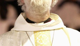 Rowan Williams, the Archbishop of Canterbury, conducts a service in Harare, Zimbabwe, on Sunday. (Associated Press)