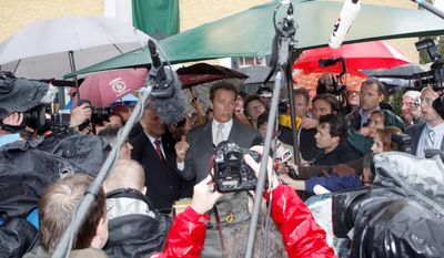 Austrian-born actor and former California governor Arnold Schwarzenegger is surrounded by journalists prior to the opening of the Schwarzenegger museum in the house where he was born in Thal near Graz, Austria, on Friday. (Associated Press)