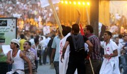 Clashes erupt Sunday at a protest of a recent attack on a church in Cairo. After midnight, mobs roamed downtown streets, attacking cars they suspected had Christian passengers. In many areas, there was no visible police or army presence to confront or stop them. (Associated Press)