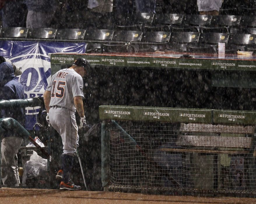 Detroit Tigers third baseman Brandon Inge goes into the dugout during rain delay at Game 1 ALCS against the Texas Rangers. Sunday's game has been postponed because of rain. (AP Photo/Eric Gay)