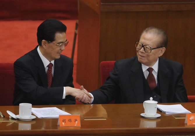 Chinese President Hu Jintao (left) shakes hands with former President Jiang Zemin at the Great Hall of the People in Beijing on Sunday, Oct. 9, 2011, after Mr. Hu delivered a speech at a conference to commemorate the centennial of the 1911 revolution that overthrew imperial rule on the mainland. (AP Photo/Minoru Iwasaki, Pool)