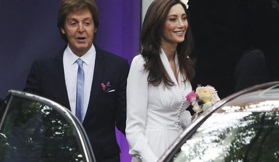 Sir Paul McCartney and Nancy Shevell leave his home in the St. John's Wood neighborhood of London on their way to be married at nearby Marylebone Town Hall on Sunday, Oct. 9, 2011. (AP Photo/Press Association, David Parry)