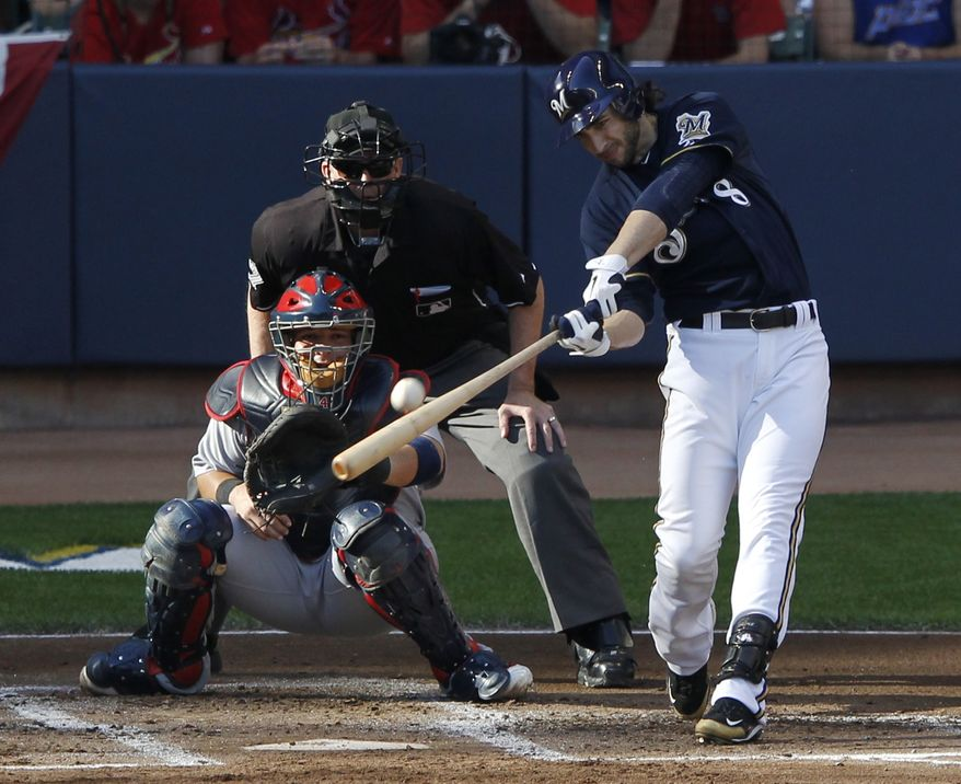 Milwaukee Brewers' Ryan Braun hits a two-run home run during the first inning of Game 1 of baseball's National League championship series against the St. Louis Cardinals Sunday, Oct. 9, 2011, in Milwaukee. (AP Photo/Jeff Roberson)