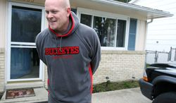 """Samuel """"Joe the Plumber"""" Wurzelbacher laughs while chatting with the media outside of his home in Holland, Ohio, in 2008. (Associated Press) ** FILE **"""