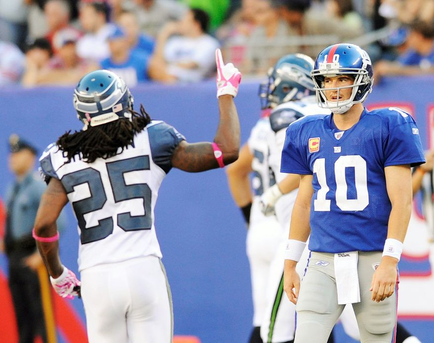 Seattle defensive back Richard Sherman (25) reacts as an interception thrown by Giants quarterback Eli Manning (10) was returned for a touchdown in the Seahawks' 36-25 win Sunday. (Associated Press)