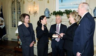 Eleni Tsakopoulos-Kounalakis, longtime friend of House Speaker Nancy Pelosi (left), was sworn in as ambassador to Hungary in January, 2010 by Secretary of State Hillary Rodham Clinton (second from right). Also in attendance were her father, Angelo Tsakopoulos, (holding Bible) and Supreme Court Justice Anthony Kennedy. Mrs. Pelosi's husband, Paul, is a longtime business associate of Mr. Tsakopoulos. (State Department)