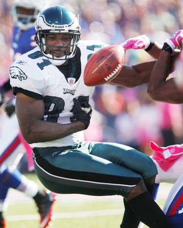Philadelphia wide receiver Jason Avant fumbles during the third quarter against Buffalo on Sunday. The Eagles, who face the Redskins this week, turned the ball over five times in losing their fourth straight game. (Associated Press)