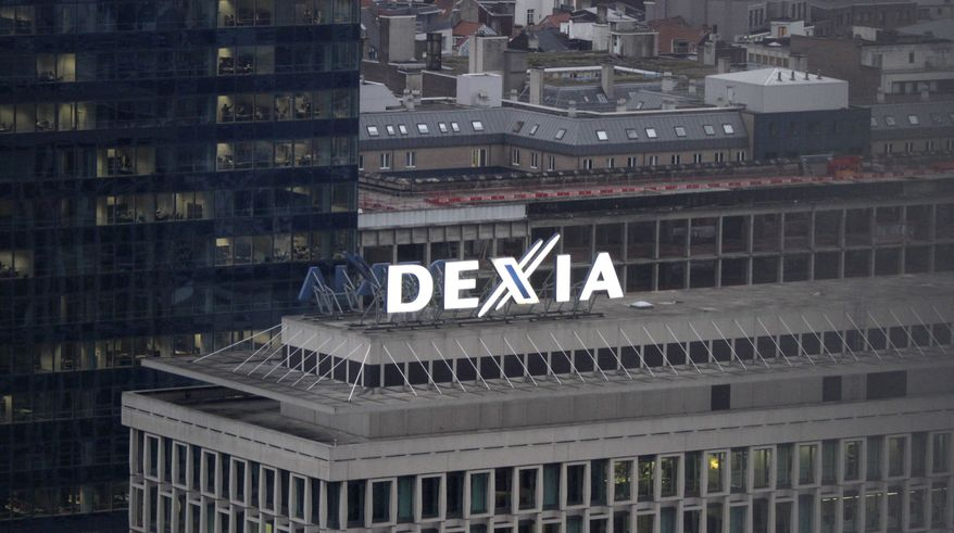 The Dexia logo sits atop the bank's headquarters in Brussels on Monday, Oct. 10, 2011. (AP Photo/Virginia Mayo)