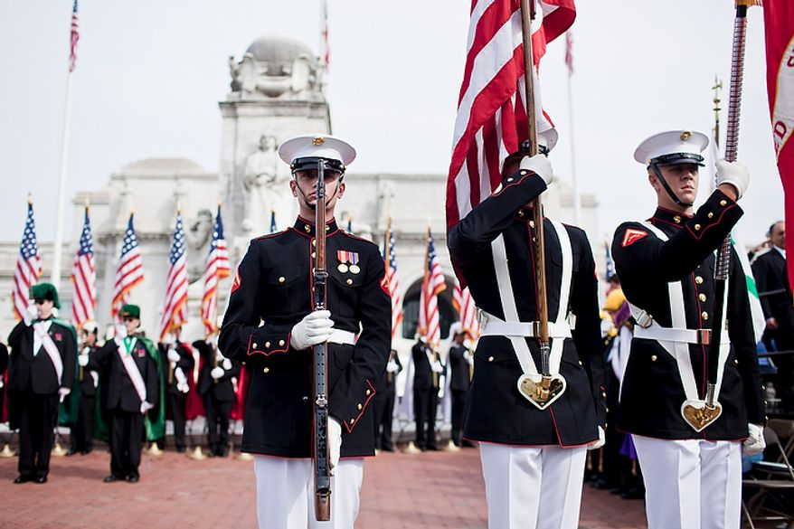 Lance Cpl. Buckridge (left), Lance Cpl. Kortus (center) and Lance Cpl. Landis of the U.S. Marine Corps Color Guard, present the flag during a Columbus Day celebration and wreath presentation at Union Station in Washington on Oct. 10, 2011. (T.J. Kirkpatrick/The Washington Times)