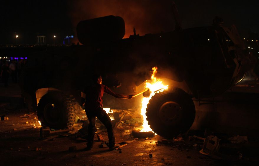 A Coptic Egyptian demonstrator sets fire to an army vehicle during clashes with Egyptian army soldiers following a demonstration in Cairo on Oct. 9, 2011. (Associated Press)