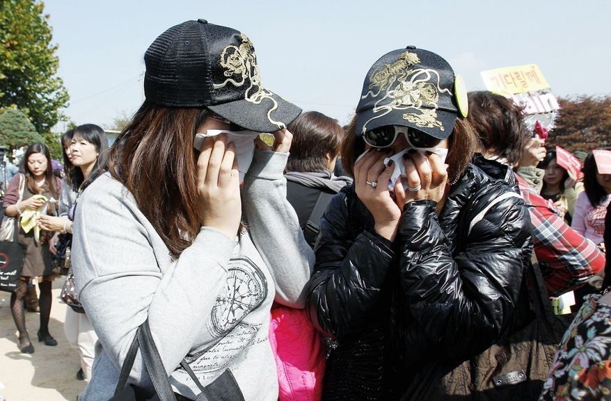Fans from many Asian countries cry after seeing Rain off as he begins fulfilling his military commitment. He's expected to be in the army for 21 months.