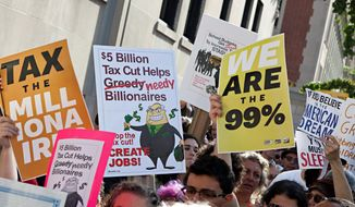 "Protesters affiliated with ""Occupy Wall Street"" wave signs and banners outside 1185 Park Avenue, where Jamie Dimon, CEO of JP Morgan Chase, lives, during a march in New York on Tuesday. The crowd marched throughout the Upper East Side neighborhood, protesting outside the homes of various billionaires and bank owners. (Associated Press)"