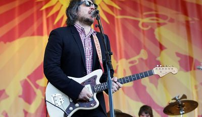 """Wilco lead singer Jeff Tweedy embraces being 44 years old. """"To be honest, at this age, I feel like what we're doing now is more punk rock than anything I could've pulled off during the conformity of punk rock,"""" he says. (Associated Press)"""