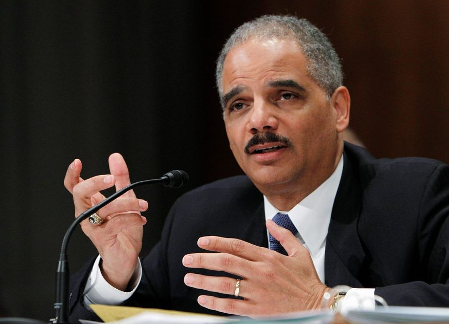 "Attorney General Eric H. Holder Jr. has been accused of a ""lack of trustworthiness"" in telling what he knew about the Bureau of Alcohol, Tobacco, Firearms and Explosives' ""Fast and Furious"" probe involving straw purchases of guns that were then ""walked"" into Mexico and given to drug smugglers. (Associated Press)"