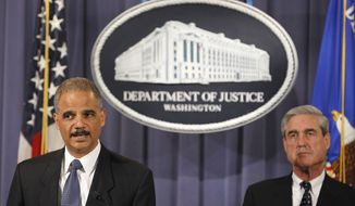 Attorney General Eric H. Holder Jr. (left), accompanied by FBI Director Robert S. Mueller III, announces on Tuesday, Oct. 11, 2011, in Washington that two men have been charged in an alleged plot directed by elements of the Iranian government to murder the Saudi ambassador to the United States. (AP Photo/Haraz N. Ghanbari)