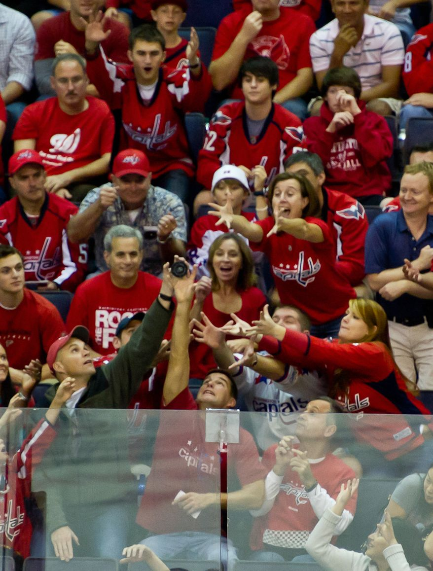 A puck is tossed out to fans in the first period as the Washington Capitals take on the Tampa Bay Lightning at the Verizon Center in Washington, D.C., Oct. 10, 2011. (Andrew Harnik/The Washington Times)