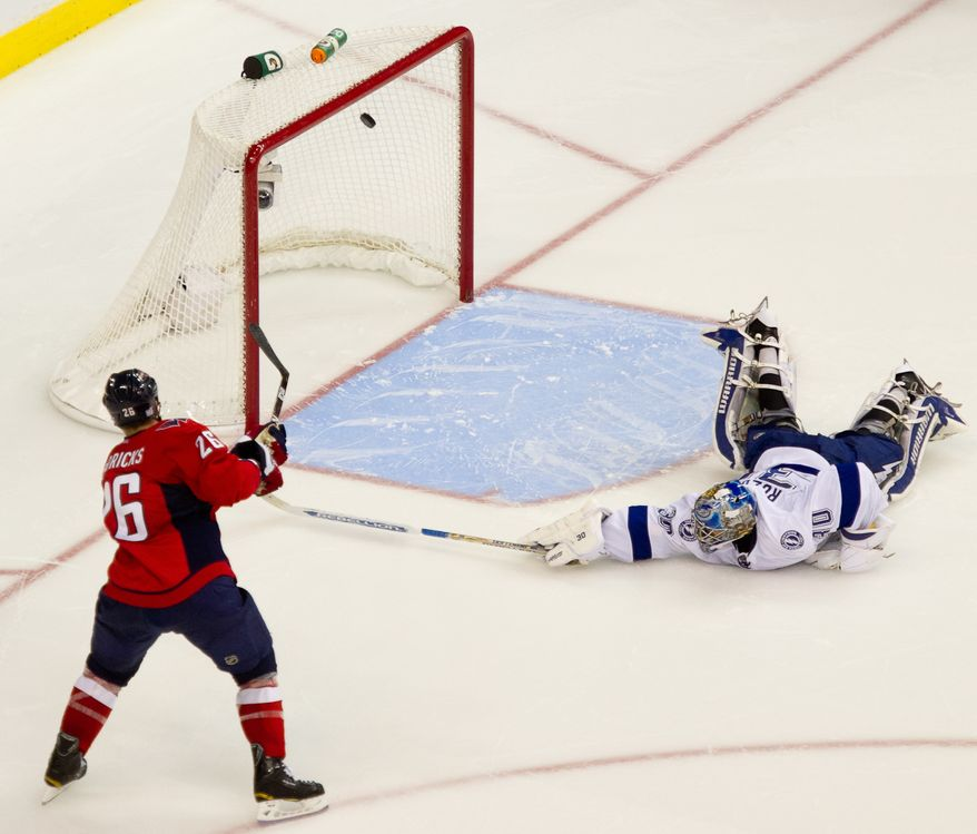 **FILE** Matt Hendricks (26) of the Washington Capitals makes the first goal in a shootout against goalie Dwayne Roloson (30) of the Tampa Bay Lightning in the Capitals' 6-5 home win on Oct. 10, 2011. (Andrew Harnik/The Washington Times)