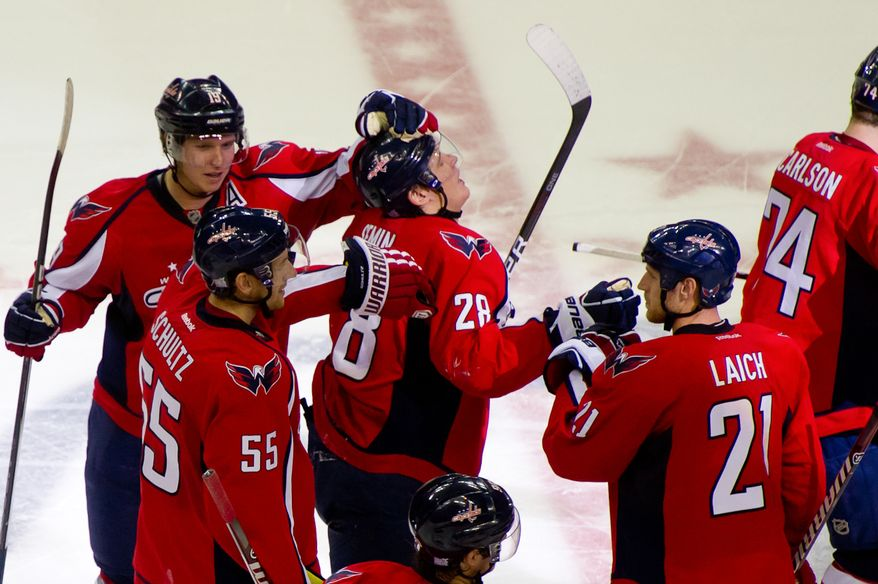 Alexander Semin (28) of the Washington Capitals celebrates with his teammates after scoring the second shot during a shootout to win the game against goalie Dwayne Roloson (30) of the Tampa Bay Lightning at the Verizon Center in Washington, D.C., Oct. 10, 2011. (Andrew Harnik/The Washington Times)
