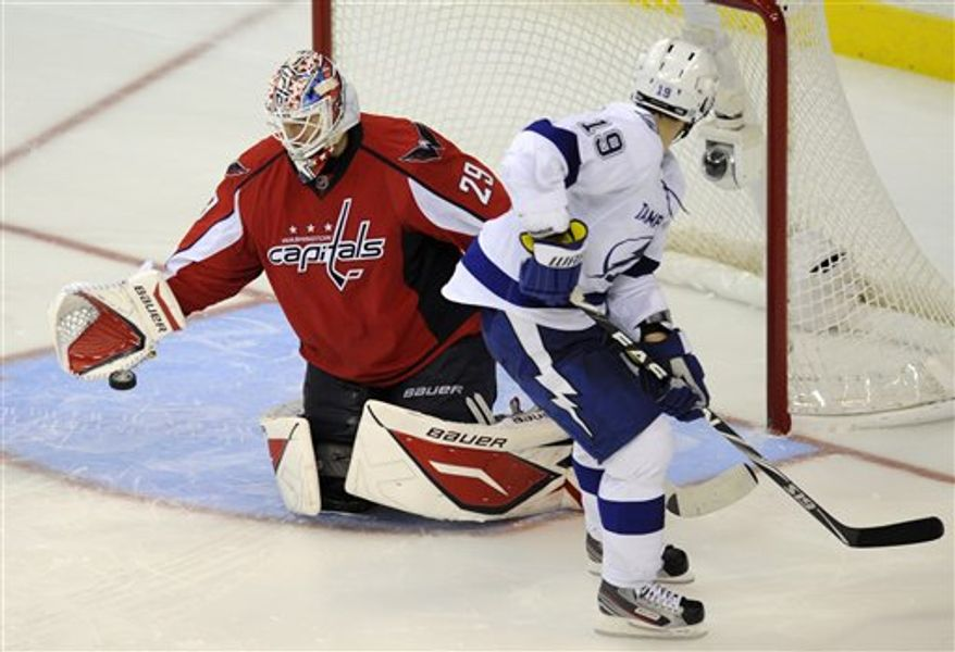 Washington Capitals goalie Tomas Vokoun (29), of the Czech Republic, stops Tampa Bay Lightning center Dominic Moore (19) during a shootout in an NHL hockey game, Monday, Oct. 10, 2011, in Washington. The Capitals won 6-5 in a shootout. (AP Photo/Nick Wass)