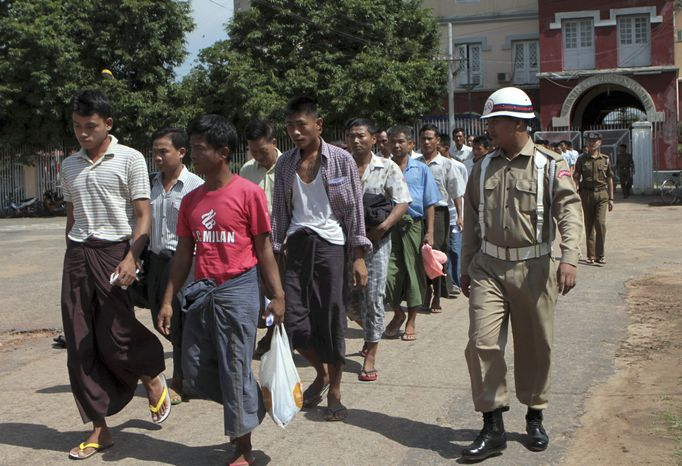 ** FILE ** Prisoners walk out of Myanmar's Insein Prison on Tuesday, May, 17, 2011, after they were granted amnesty by the government. (AP Photo/Khin Maung Win)
