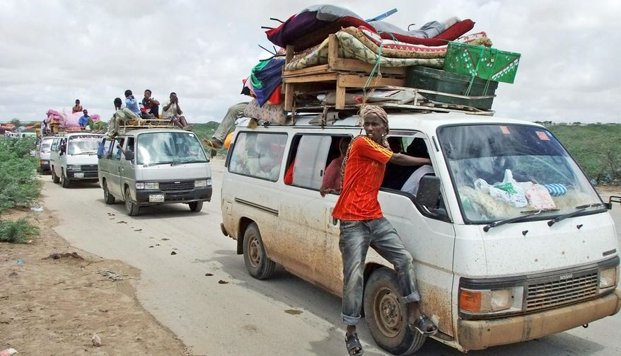 Civilians flee from a part of Mogadishu where al-Shabab is digging trenches and African Union forces are moving in. (Associated Press)