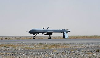 A U.S. Predator unmanned drone armed with a missile sits on the tarmac of Kandahar military airport in Afghanistan in June 2010. Defense Secretary Leon E. Panetta has praised the Predator for its precision-targeting ability, which minimizes collateral damage. (Associated Press)