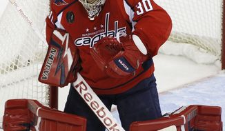 "Washington Capitals goalkeeper Michal Neuvirth is day to day with a ""lower-body injury"" and his status for Thursday's game against the Pittsburgh Penguins is in doubt. (AP Photo/Luis M. Alvarez)"