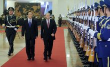 Russian Prime Minister Vladimir Putin (right) and Chinese Premier Wen Jiabao (center) attend a welcoming ceremony at the Great Hall of the People in Beijing on Oct. 11, 2011. (Associated Press/RIA Novosti)