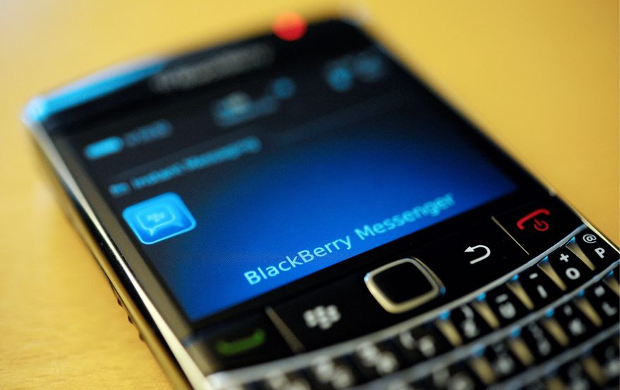 "**FILE** This photo taken Sept. 8, 2011, shows a BlackBerry smartphone using the ""Messenger"" service in Berlin. (Associated Press)"