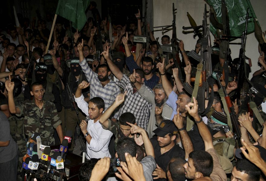 Palestinian Hamas supporters celebrate the announcement of a prisoner swap deal with Israel, in the Jebaliya refugee camp, northern Gaza Strip on Oct. 11, 2011. Israeli and Hamas have reached a deal to free captured Israeli soldier Gilad Schalit, held by Hamas-linked militants in the Gaza Strip since 2006, in exchange for hundreds of Palestinian prisoners, officials from both sides said. (Associated Press)