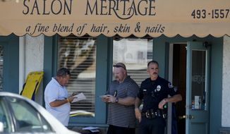 Investigators stand near the site where six people were killed and three were wounded in a shooting at a hair salon in Seal Beach, Calif., Wednesday, Oct. 12, 2011. The deaths were confirmed and the other three victims were taken to a hospital in critical condition, police Sgt. Steve Bowles told The Associated Press. (AP Photo/Chris Carlson)