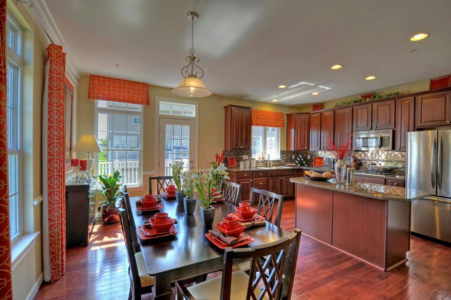 The center-island kitchen in the Fairgate model has 42-inch oak cabinets and granite counters. The Fairgate is base-priced from $399,990.