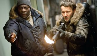"Adewale Akinnuoye-Agbaje (left) and Joel Edgerton are gruff American heavies who hang around long enough to provide some muscle when the going gets tough in the latest version of ""The Thing."" (Universal Pictures via Associated Press)"