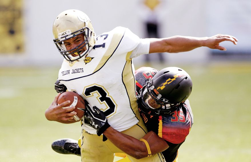 Maryland linebacker Alex Twine made two stops on Tevin Washington after the Georgia Tech quarterback ran past him for a touchdown earlier in the Yellow Jackets' 21-16 win last Saturday. (Associated Press)