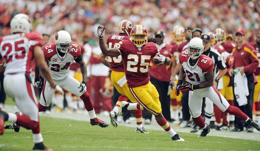 Redskins running back Tim Hightower, who's battling a shoulder injury, has just 65 yards on 22 carries in the past two games. He's sharing carries with Ryan Torain and Roy Helu. (Andrew Harnik/The Washington Times)