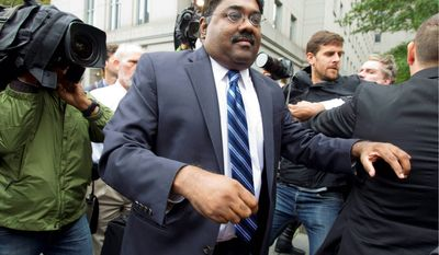 Raj Rajaratnam, co-founder of Galleon Group LLC, leaves federal court in New York after being sentenced. (Associated Press)