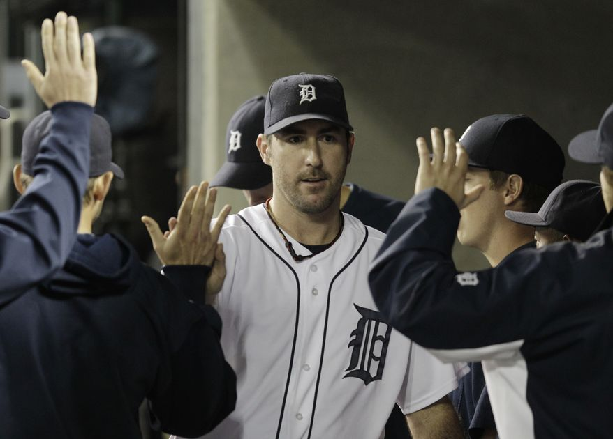 Detroit Tigers starting pitcher Justin Verlander walks in the dugout after being relieved in the eighth inning in Game 5 of the ALCS against the Texas Rangers. Verlander threw 7 1/3 innings, allowed eight hits, four runs and struck out eight in the Tigers' 7-5 win. (AP Photo/Paul Sancya)