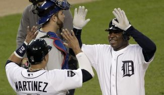 Detroit Tigers' Delmon Young hit two home runs and against the Texas Rangers on Thursday. The Tigers won 7-5 to stay alive in the ALCS. (AP Photo/Duane Burleson)