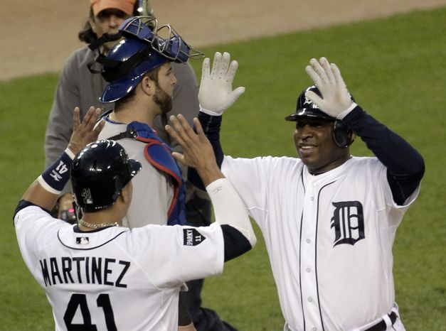 Detroit Tigers' Delmon Young hit two home runs and against the Texas Rangers on Thursday. The Tigers won 7-5 to stay alive in the ALCS