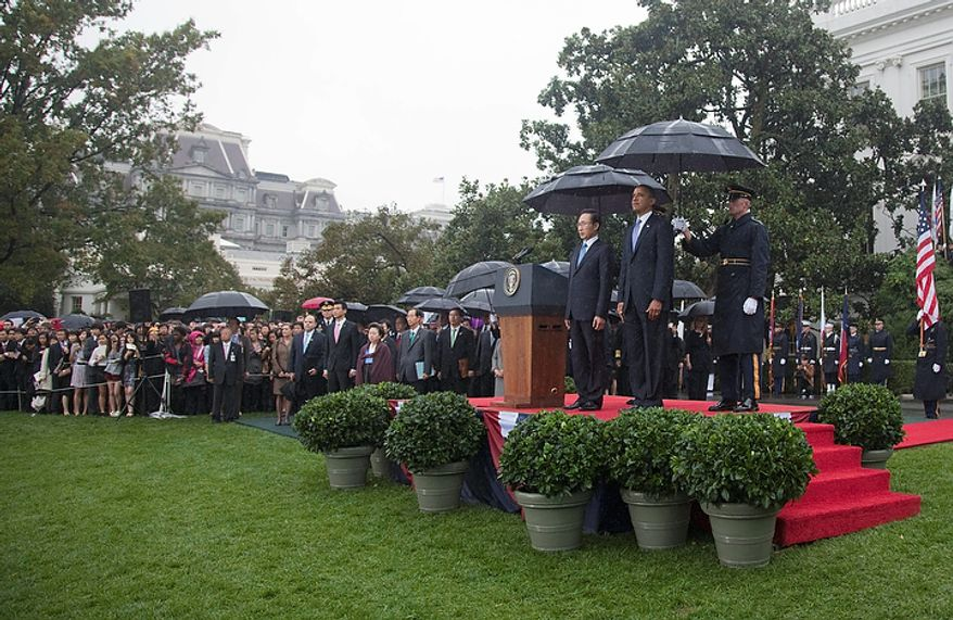 President Obama welcomes South Korean President Lee Myung-bak during a state arrival ceremony on the South Lawn of the White House in Washington on Thursday, Oct. 13, 2011. (AP Photo/Evan Vucci)